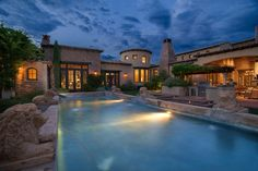 Mediterranean Swimming Pool with Outdoor kitchen, Trellis, Arched window, Casement, exterior stone floors, picture window