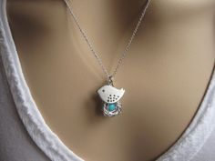 Mother Bird, Egg Nest, Silver Necklace, Gift for Expectant Mommy, Only Child. New Baby, Cute little bird, Silver Necklace. $26.00, via Etsy.