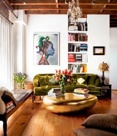 .the coffee table - the sofa -the exposed beams, the chaise. very bohemian and relaxing yet elegant and sexy. nice mix.