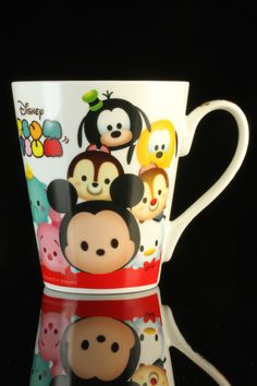 "Disney ""Tsum Tsum"" Mug. The rounded ""Tsum Tsum"" Disney characters suffer for the impossible cuteness that only Japan can do. The images are from toys that stack neatly upon one another, thus the delightful pile of faces on the mug. Interior ""Tsum Tsum"" levels measure the fullness of your brew. Ceramic mug stands 4 inches and flares to 3 1/2 inches at the brim."