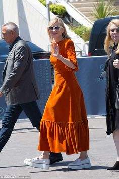 Tangerine dream! Oscar winner Cate Blanchett, 49, opted for a quirky tangerine corduroy dr...