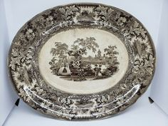 Center of platter is raised. Crazing throughout. This item is being sold as part of an estate sale liquidation. Porcelain Ceramics, Ceramic Bowls, Stoneware, Pink Rims, Antique Windows, Radiator Cover, Dinner Plate Sets, Pottery Bowls, Jar Lids