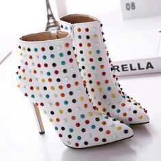 Riveting high-heeled boots