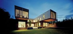 traditional-facade-hides-thoroughly-renovated-contemporary-residence-4-rear-angle-dark.jpg