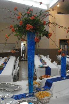 Blue gel filled vases w/orange flowers