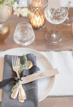 silverware tied with a ribbon and an herb sprig - very simple but stl very pretty