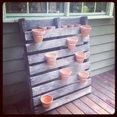 Vertical garden, but instead of plants I want to put my soup can luminaries or mason jars. For the big wall on my back porch.