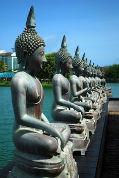 A set of Thai styled Buddha statues at the Gangarama temple - photo by Geethaka Jayasuriya