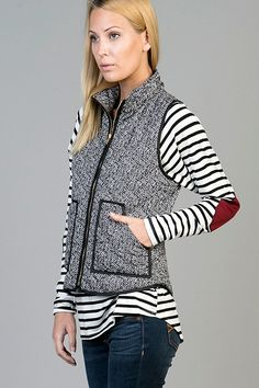The black and white herringbone pattern vest is complimented with black trim and front zipper. This looks great with practically everything. 100% Polyester Contrast: 100% Nylon Made in the USA