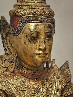Closeup of Face of Crowned Buddha Seated on Elephant Throne Burma (Myanmar) 19th century CE Gilded and lacquered wood with paint and colored glass