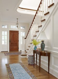 I love large entryways with a beautiful staircase. I also love balconies and lots of windows.