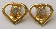 A small pair of clip on heart shaped earrings in gold tone metal with central embedded faceted crystal stones Circa 1980 Measurement the earrings are Vintage Wedding Jewelry, Heart Shaped Earrings, Faceted Crystal, Stones And Crystals, Clip On Earrings, Heart Shapes, Heart Ring, Cufflinks, Pairs