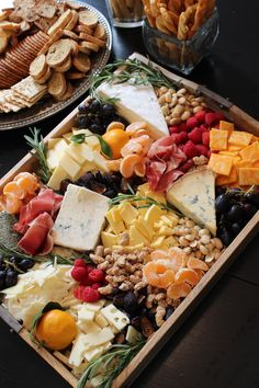 rustic fall cheese and fruit tray...arrangement of cheese, meats, fruits, nuts, herbs with crackers and breads