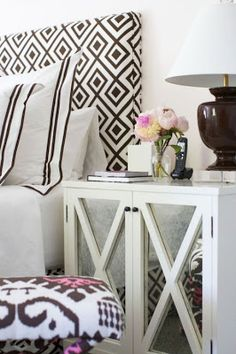 a touch of black. Love the headboard and the ikat stool