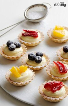 Frozen mini tart shells are your best time-saving weapons in this super easy #recipe. These bite-size Mini Fruit Tarts are small in size, big in flavour and a sensation at every party! Tap or click photo for recipe.