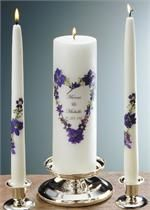 Wedding Unity Candle Violet Bouquet Purple and Blue Larkspur and Verbena complimented with White Alyssum make a beautiful arrangement with this design. The 3x9 candle includes a 4 line, 15 characters per line personalization, clear wrapping and color coordinated ribbon. Tapers included. Candle holders not available. Great for weddings, centerpieces, and holiday gifts.