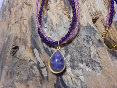 Purple/pink necklace. Pendant is vintage by Purrwoof on Etsy, $12.00