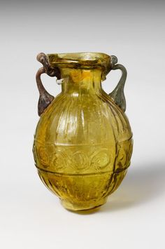 Glass amphoriskos (flask). Period: Early Imperial. Date: 1st century CE. Culture: Roman. Medium: Glass; blown in a two-part mold.