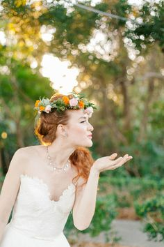 What an adorable bride! We love this bright floral crown! {@jenreillykelmer}