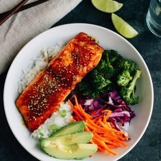 These Teriyaki Salmon Bowls come together quickly for a healthy and delicious weeknight meal. Serve in a bowl with rice, fresh veggies and creamy avocado.