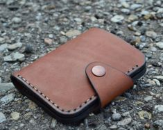This mini version of my traditional snap wallet is secure and stylish. Easily fits credit cards, cash, and business cards. Check out all our wallet varieties. A great gift for family, friends, and yourself!  The leather I hand select is luxurious veg tan cowhide of the highest quality. I hand cut and dye each wallet and saddle stitch by hand using waxed linen cord.   - Measures approximately 4 X 3. - in the above photos are 7 credit cards, 4 bills . I can also make to order