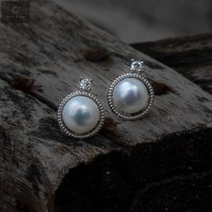 Pure silver studs with pearls that are attractive and beautiful in nature #silver #silverjewellery #pearls #pearljewellery #zirconiastones #studs #silverstuds #beautifulearrings #silverstore #pearlearrings #silverornaments #pearlstuds #earringswithpearls #stonedearrings #earringswithstone