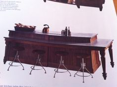 Kitchen counter with a low bar, bar stools, rustic kitchen