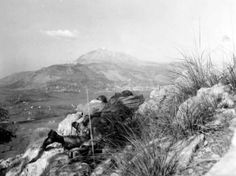 Looking toward Cassino, a key mountain stronghold obstructing the Allied drive toward Rome, advance American scouts gaze at the stubbornly d...