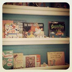 DIY Rain Gutter Bookshelves for toy room.