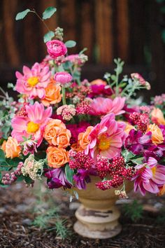 Dahlia, spray rose, cottage yarrow, service berry, ranunculus, and alstroemeria flower centerpiece.