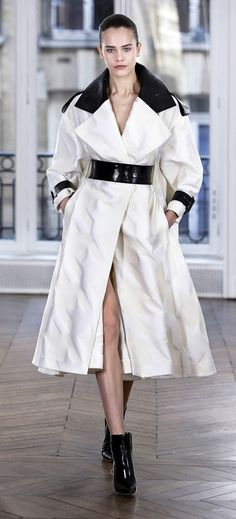 Snow white contrasting satin jacquard silk oversized houndstooth coat featuring black crinkled leather tie-belt, pockets and lapels.
