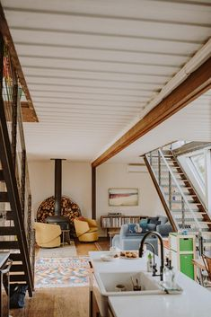 A modern shipping container home with open floor plan.