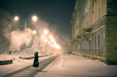 The young photographer traveled to Norilsk, one of the biggest cities above the Arctic Circle. In Norilsk, inhabitants live in darkness 45 days a year, temperatures can drop to minus 53 °C in the W…