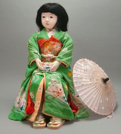 Miss Yamaguchi, Friendship Doll, Torei Ningyo. Composition (face and body), hair, glass (eyes), silk, cotton. Taisho period, 1927, Japan.  Museum of International Folk Art, Gift of the Art Institute of Chicago. Photo by Paul Smutko.