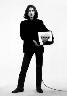 Jim holding a TV with an image of Andy Warhol