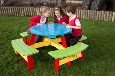 Multi-coloured painted picnic table designed for Primary School Children. #picnictable #kids #school