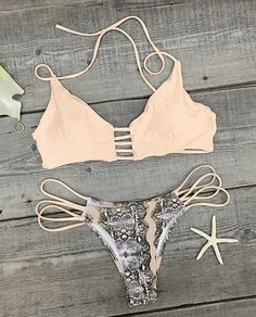Hot girl,give this summer even more pop! Make it memorable in our Detail It All Bikini Set. Match halter top with stylish strappy bottom for the perfect beach ensemble.