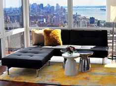 Google Image Result for http://cdn.decoist.com/wp-content/uploads/2012/08/bachelor-pad-decor-modern-sofa-and-coffee-table.jpg::I like the combo of black leather and yellow for dining room, maybe switch it to brown leather and green for less modern