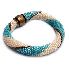 Turquoise Bracelet Turquoise and cream bracelet Tubolar crochet... ($27) ❤ liked on Polyvore featuring jewelry, bracelets, gold beaded jewelry, magnet jewelry, glass bead jewelry, green turquoise jewelry and beads jewellery