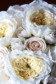 David Austin Roses mixed with more traditional hybrid tea roses and spray roses all in shades of white to cream to porcelain. The varried shades give depth and texture.