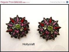 Hollycraft Rheinstone Clip on earrings 1954 purple flower by serendipitytreasure on Etsy https://www.etsy.com/listing/220027153/hollycraft-rheinstone-clip-on-earrings