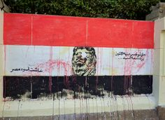 Graffiti stencil reads 'Even if he lost both eyes, he'll still be a lion. Long Live Egypt's Lions'