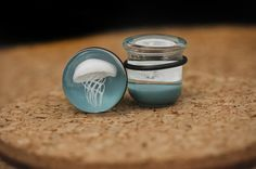 Inspired by the ocean, and put into your ears! Handmade jellyfish plugs! Each pair is one of a kind!    Single flared - Includes o-rings!     White Jellyfish on Aqua background    Looking for a different size?