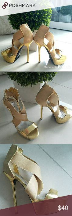 Gorgeous Bebe Gold heels 6 high Awesome bebe heels size 6 barely worn. 2 or 3 times tops. Very minor wear and scrapes as shown in pics. Some wear due to storage in straps barely noticeable. They look A - MA-ZING on!! Bebe Shoes Heels