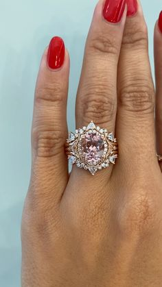 This wedding ring set, comprised of two Tempest bands hugging our Margarette engagement ring with a stunning oval morganite stone is beyond compare. All three rings are made in a bright, blushing rose gold and have vintage inspired designs. Margarette has a unique vintage inspired diamond halo that encompasses a breathtaking oval morganite stone. Tempest is a contoured diamond wedding band with trillion and round stones that perfectly compliments Margarette's shape. See these two on our…