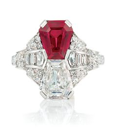 www.doylenewyork.com, Doyle New York, Art Deco Platinum, Ruby and Diamond Ring   Set with one shield step-cut ruby approximately 2.01 cts., and one shield step-cut diamond approximately 1.40 cts., flanked by 8 baguette and fancy-shaped diamonds, set with 50 single-cut diamonds, circa 1920, engagement, engagement ring, diamond ring, bride, bridal, wedding, noiva, عروس, زفاف, novia, sposa, כלה