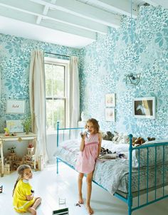 In the Brooklyn home of Miranda Brooks and Bastien Halard, seen here in 2013, daughter Violette Grey's bedroom walls are covered in hand-printed horse-chestnut wallpaper.