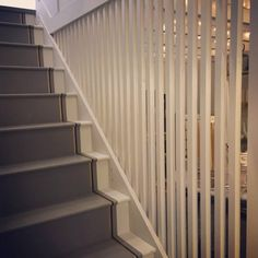 The stairs... Our Interior Designer Donna Marie spent hours painstakingly painting the stripes on and don't they just look amazing! Tytti designed the Scandi style staircase and her Dad dutifully took the flights from Finland to build it. Team effort!  Colours: Farrow & Ball Cornforth White no228 on the spindles and the sides of the stairs, Mole's Breath no 276 on the steps and next to Cornforth White, Railing no 31 as a dark blue stripe with a stripe of gold. Magic eh? — at Curated Stories.