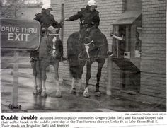 Mounted Toronto police constables Gregory John (left) and Richard Cooper take their coffee break in the saddle yesterday at the Tim Horton's shop on Leslie St. at Lake Shore Blvd. Their steeds are Brigadier (left) and Spencer. Miss Canada, Good Drive, Redbone Coonhound, I Am Canadian, Urban Cowboy, Country Strong, Tim Hortons, Happy Trails, Toronto Canada