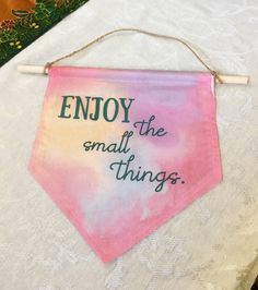 Wall hanging banner Enjoy the Small Things quote by yayhooray